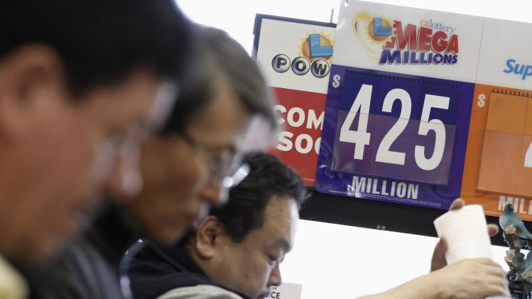 Workers at Bluebird Liquor sell Mega Millions lottery tickets in Hawthorne, California
