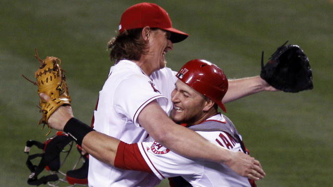 Los Angeles Angels starting pitcher Jered Weaver celebrates his no hitter against the Minnesota Twins  with catcher Chris Iannetta at a baseball game in Anaheim, Calif., Wednesday, May 2, 2012. (AP Photo/Chris Carlson)