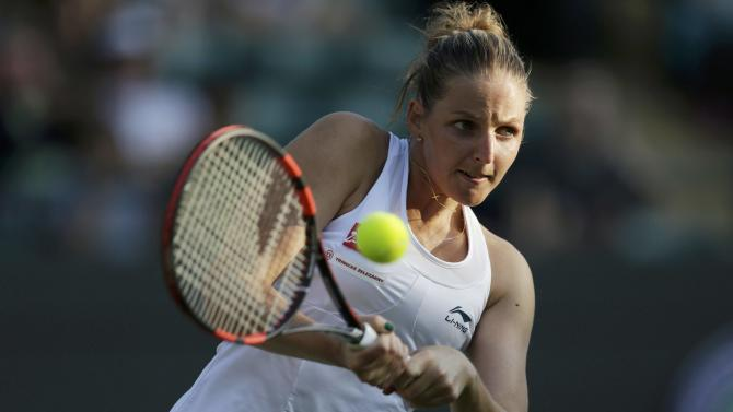 Kristyna Pliskova of the Czech Republic hits a shot during her match against Svetlana Kuznetsova of Russia at the Wimbledon Tennis Championships in London