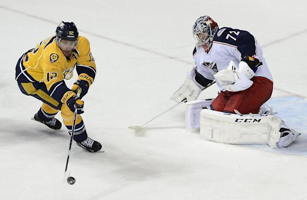 Nashville Predators forward Mike Fisher (12) tries to get a shot off at Columbus Blue Jackets goalie Sergei Bobrovsky (72), of Russia, in the third period of an NHL hockey game on Saturday, March 8, 2