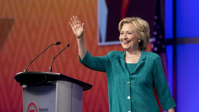 Democratic presidential candidate Hillary Rodham Clinton waves as she is introduced before speaking to the National Urban League, Friday, July 31, 2015, in Fort Lauderdale, Fla. (AP Photo/Wilfredo Lee)