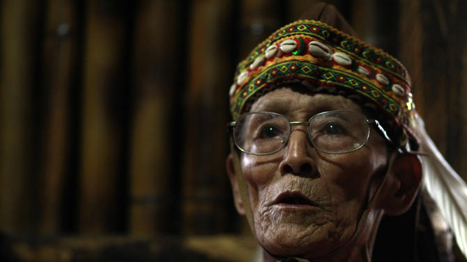 In this photo Saturday, Dec. 8, 2012, eighty-year-old Mu'u Ka'angena is seen in the communal bamboo hut of his aboriginal Kanakanvu mountain village of Dakanua, southern Taiwan, speaking about the fear of his dying tribal language. In a race against time, a dedicated Taiwanese linguist is trying to save the historically important aboriginal dialect of Kanakanvu, spoken by only 10 people, from extinction. (AP Photo/Wally Santana)