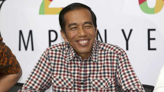 "Indonesian presidential candidate Joko Widodo, popularly known as ""Jokowi"" smiles during a press conference in Jakarta, Indonesia, Thursday, July 10, 2014. Jakarta Governor Joko ""Jokowi"" Widodo and former army general Prabowo Subianto are both claiming victory in Indonesia's presidential election based on unofficial ""quick counts,"" raising the specter of prolonged political instability in Southeast Asia's largest economy. (AP Photo/Tatan Syuflana)"