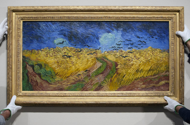 Curators remove Vincent van Gogh&#39;s painting &quot;Wheatfield with Crows,&quot; from the wall of the Van Gogh Museum in Amsterdam, Netherlands, Sunday, Sept. 23, 2012. While the museum closes for seven months for renovations, 75 works by the Dutch painter will be displayed instead across town at The Hermitage, an Amsterdam satellite of the Russian state museum. The tricky process of transporting the artworks under police escort began immediately after the last visitors left the museum Sunday evening and carried on through the night into Monday morning. The Van Gogh Museum reopens April 25, 2013. (AP Photo/Cris Toala Olivares)