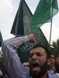 Supporters of the Sunni Muslim Jamaa Islamiya group shout slogans during a rally in central Beirut. The violence erupted hours after reports emerged that troops had shot dead Sheikh Ahmad Abdul Wahid, a prominent anti-Syria Sunni cleric, when his convoy failed to stop at a checkpoint in north Lebanon on Sunday. Another cleric in the car was also killed