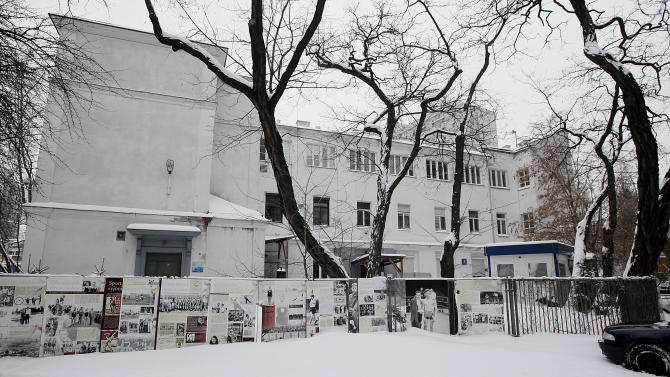 "People walk in front of Warsaw's Jewish community center, known as the ""white building"" in Warsaw, Poland, Friday, Jan. 25, 2013. The building, one of the few surviving remnants of the infamous Warsaw Ghetto, could be torn down to make way for a taller modern building, a plan that has angered advocates of historic preservation and sparked a battle to save the structure. The Jewish community defends the plan, saying it needs to build a larger and newer building on the spot to accommodate a growing community. (AP Photo/Czarek Sokolowski)"