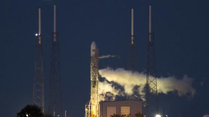 The unmanned Space Exploration Technologies' Falcon 9 rocket is seen before liftoff at Cape Canaveral, Florida