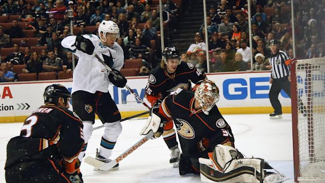 Anaheim Ducks goalie Frederik Andersen makes a save as San Jose Sharks center Tomas Hertl looks down during the first period of an NHL hockey game Monday, Dec. 22, 2014, in Anaheim, Calif. (AP Photo/Lenny Ignelzi)