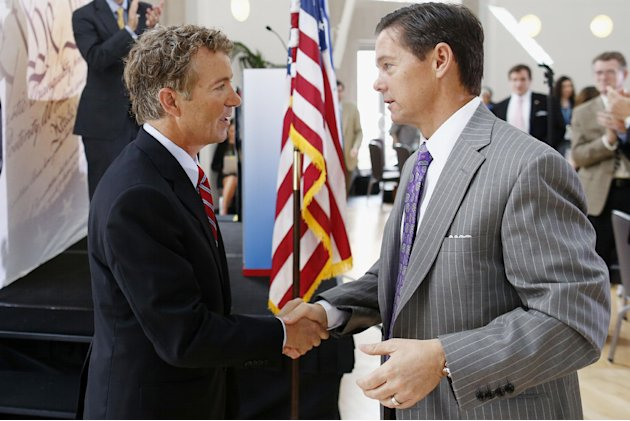 "FILE - In this June 13, 2013, file photo, Sen. Rand Paul, R-Ky., left, shakes hands with Ralph Reed, founder of the Faith and Freedom Coalition, after he addressed their ""Road to Majority"" conference"