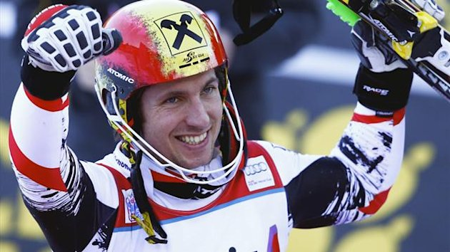 Marcel Hirscher of Austria celebrates before the podium ceremony after winning the men's World Cup Slalom ski race (Reuters)
