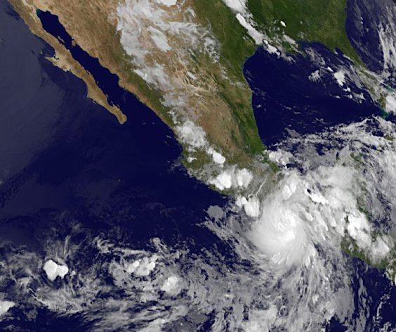 This image provided by NASA acquired Friday at 11 p.m. EDT shows Hurricane Carlotta slammed into Mexico's resort-studded Pacific coast late Friday, toppling trees and lashing hotels while authorities evacuated people from low-lying areas. The rapidly changing hurricane made landfall as a Category 1 storm near Puerto Escondido, a laid-back port popular with surfers, and is expected to push inland and northward in the direction of Acapulco. (AP Photo/NASA)
