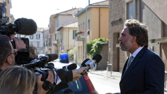 Francesco Pepe, lawyer of Capt. Francesco Schettino, talks to the media prior to the preliminary, closed-door hearing for the 2012 grounding off Tuscany that killed 32 people, in Grosseto, Italy, Monday, April 15, 2013. An Italian court is mulling whether to hand down indictments against the captain and some crew of the Costa Concordia cruise ship for the 2012 grounding off Tuscany that killed 32 people. Prosecutors want Capt. Francesco Schettino to stand trial for alleged manslaughter, causing a shipwreck and abandoning the ship before all passengers had been evacuated. They want four other crew members and a Costa manager to face charges of having botched the emergency Schettino attended the preliminary, closed-door hearing Monday in the Tuscan city of Grosseto; the timing of a decision was unknown. (AP Photo/Andrew Medichini)