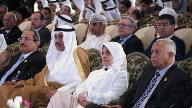 Yemeni FM Riyad Yassin (R), Kuwaiti Minister of Social Affairs and Labor Hind Al-Sabeeh, Kuwaiti deputy PM and Foreign Affairs Minister al-Sabah, attend the opening ceremony of the annual Arab Labour Conference, in Kuwait City, on April 19, 2015