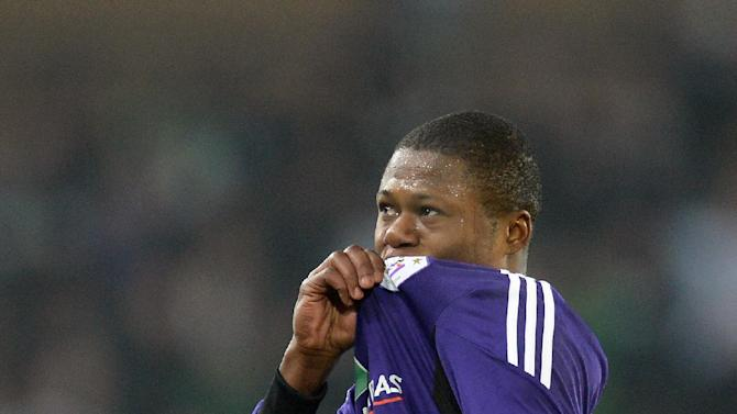 RSC Anderlecht's Chancel Mbemba celebrates after he scored during the Group C Champions League soccer match against SL Benfica in Brussels on Wednesday, Nov. 27, 2013