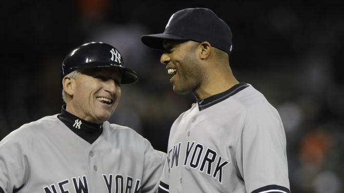 New York Yankees first base coach Mick Kelleher, left, congratulates New York Yankees relief pitcher Mariano Rivera after their 5-3 win over the Detroit Tigers in a baseball game, Monday, May 2, 2011, in Detroit. (AP Photo/Carlos Osorio)