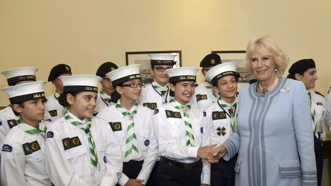 Britain's Camilla, the Duchess of Cornwall, stands with sea scouts as she visits the United Kingdom Ambassador's Residence for a meeting with sailors, veterans and scouts from HMS Bulwark in Valletta