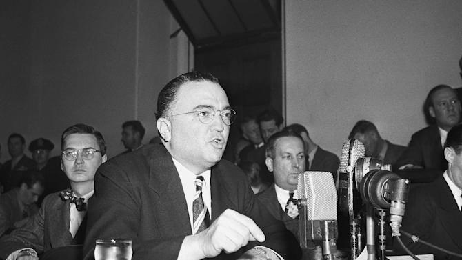 """FILE - This March 26, 1947, file photo shows Federal Bureau of Investigation Director J. Edgar Hoover calling the communist party of the United States a """"Fifth Column"""" whose """"goal is the overthrow of our government"""" during testimony before the House Un-American Activities Committee in Washington. Fearing a Russian invasion and occupation of Alaska, the U.S. government in the early Cold War years recruited and trained fishermen, bush pilots, trappers and other private citizens across Alaska for a covert network to feed wartime intelligence to the military, newly declassified Air Force and FBI documents show. Hoover teamed up on a highly classified project, code-named """"Washtub,"""" with the newly created Air Force Office of Special Investigations, headed by Hoover protege and former FBI official Joseph F. Carroll. (AP Photo/File)"""