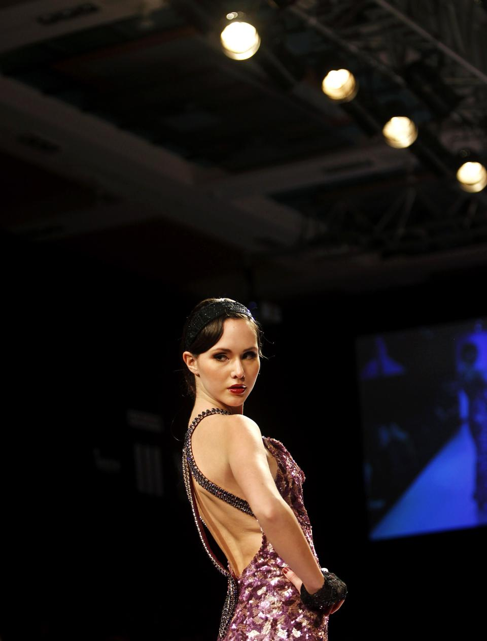 An Indian model displays a creation by Komal Sood during the Lakme Fashion Week in Mumbai, India, Saturday, Aug. 4, 2012. (AP Photo/Rafiq Maqbool)