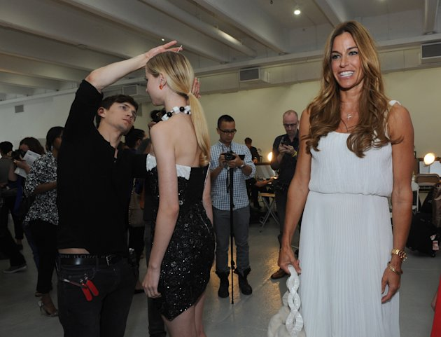 IMAGE DISTRIBUTED BY L'OREAL PROFESSIONNEL  - Kelly Bensimon, center, looks on as a LíOreal Professionnel stylist, left, preps a modelís hair backstage before the Alice + Olivia spring 2013 presentati