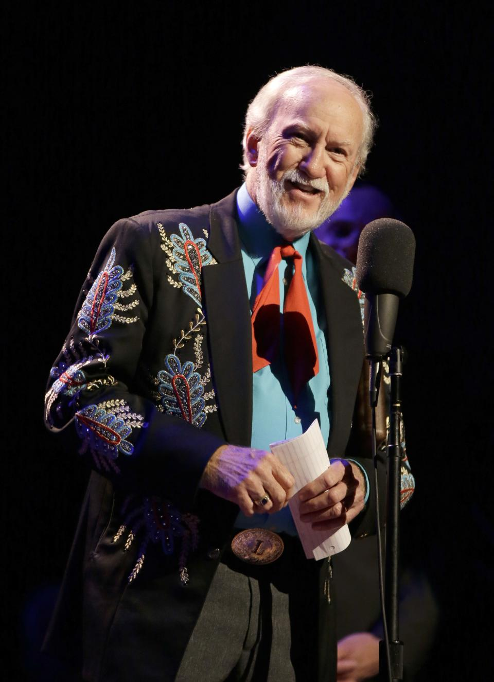 Doyle Lawson speaks after being inducted into the International Bluegrass Music Hall of Fame on Thursday, Sept. 27, 2012, in Nashville, Tenn. (AP Photo/Mark Humphrey)