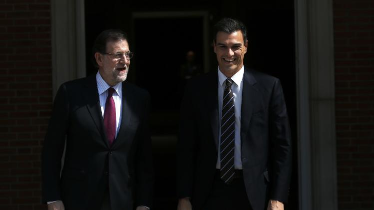 Spanish Prime Minister Mariano Rajoy welcomes new Secretary General of Spain's Socialist Party (PSOE) Pedro Sanchez