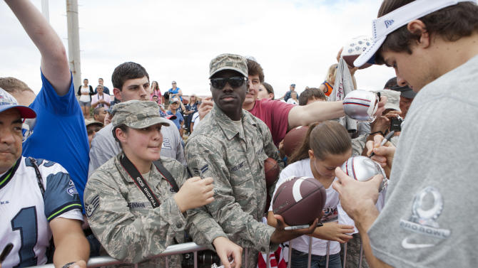 Fans line up for autographs during NFL Pro Bowl Practice at Joint Base Pearl Harbor Hickam, Thursday, Jan. 24. 2013 in Honolulu.  (Marco Garcia/AP Images for USAA)