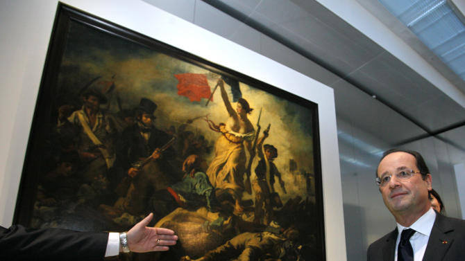 "FILE - This Tuesday, Dec. 4, 2012, file photo shows France's President Francois Hollande in front of ""Liberty Leading the People"", a painting by Eugene Delacroix during the inauguration of the Louvre Museum in Lens, northern France. A visitor to the Louvre's newest extension, in northern France, has been detained after scrawling an inscription in marker on the famed canvas of Eugene Delacroix ""Liberty Leading the People"". The 28-year-old woman was immediately seized by a guard and another visitor, then handed over to police, according to a statement from the Louvre-Lens on Friday Feb 8 2013. It said the painting should be easily cleaned. (AP Photo/Michel Spingler, File)"