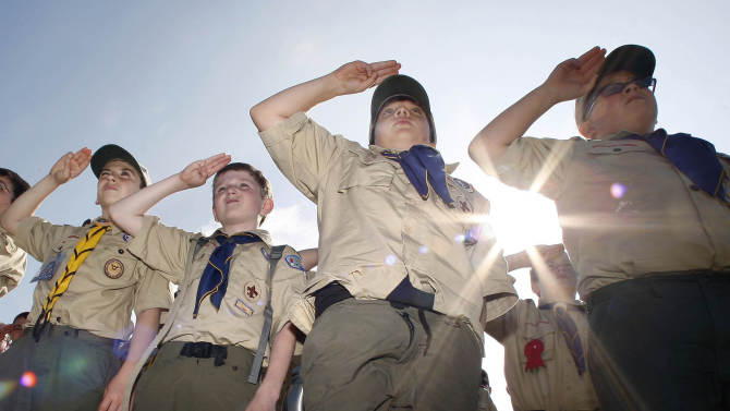Boy Scouts salute early Saturday morning, May 21, 2011 during New Jersey's Boy Scouts Camporee in Sea Girt, N.J. The Boy Scouts of America's National Council has voted to ease a long-standing ban and allow openly gay boys to be accepted as Scouts, Thursday, May 23, 2013. Of the local Scout leaders voting at their annual meeting in Texas, more than 60 percent supported the proposal. (AP Photo/Mel Evans, file)