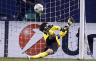 Lyon's goalkeeper Hugo Lloris lets the goal in during the Champions League group D soccer match between Dinamo Zagreb and Lyon, in Zagreb, Croatia, Wednesday, Dec. 7, 2011. (AP Photo/Darko Bandic)