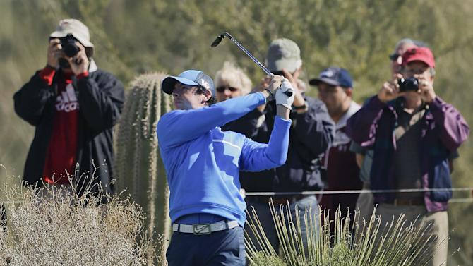 Rory McIlroy, of Northern Ireland, hits an approach shot off the 10th fairway during a practice round for the Match Play Golf Championship tournament, Tuesday, Feb. 19, 2013, in Marana, Ariz. (AP Photo/Julie Jacobson)