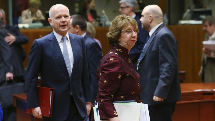 EU foreign policy chief Ashton and Britain's Foreign Secretary Hague arrive at a EU foreign ministers meeting in Brussels