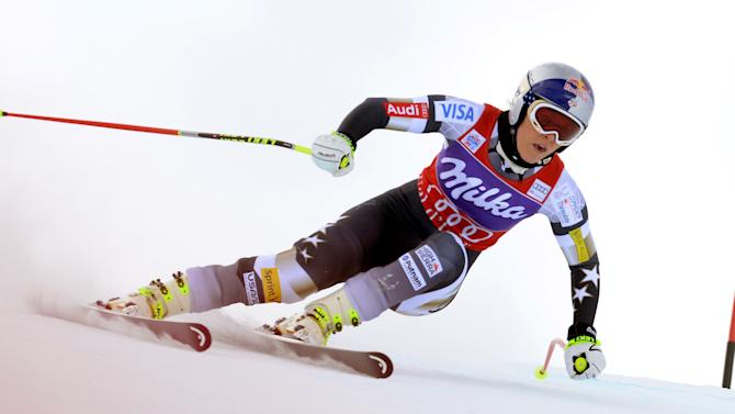 Lindsey Vonn of United States competes during training for an alpine ski, women's World Cup downhill in Val d'Isere, France, Friday, Dec. 19, 2014. Austrian skier Anna Fenninger posted the fastest time in a World Cup downhill training run ahead of countrywoman Regina Sterz and Lindsey Vonn on Friday. (AP Photo/Pier Marco Tacca)