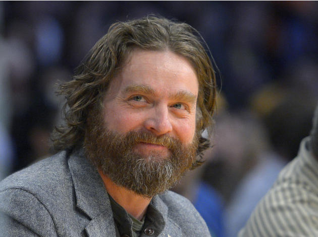 FILE - In this Feb. 28, 2013 file photo, actor Zach Galifianakis watches the Los Angeles Lakers play the Minnesota Timberwolves in their NBA basketball game in Los Angeles. President Barack Obama is h
