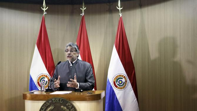 Paraguay's President Fernando Lugo gives a press conference at the Mburuvicha Roga presidential residence in Asuncion, Paraguay, Wednesday, June 20, 2012.  Lugo announced the creation of an independent commission to investigate the deaths of 11 landless farmers and six police during gun battles on June 15 in Curuguaty, Paraguay. The violence broke out as police tried to evict about 150 farmers from the reserve, which is part of a huge estate owned by a Colorado Party politician opposed to Lugo. (AP Photo/Jorge Saenz)