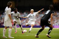 Stephanie Houghton, centre, scores the free-kick that won Team GB the game