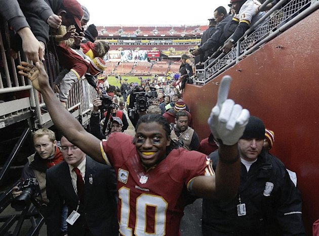 Washington Redskins quarterback Robert Griffin III (10) greets fans as he leaves the field after an NFL football game against the Philadelphia Eagles in Landover, Md., Sunday, Nov. 18, 2012. The Redsk