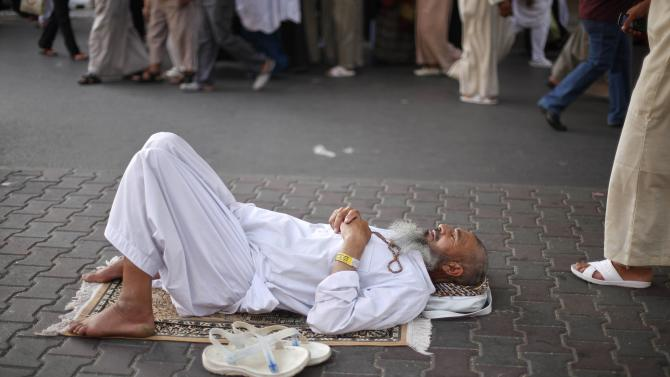 A Muslim pilgrim rests near the Grand Mosque in Mecca, ahead of the annual haj pilgrimage