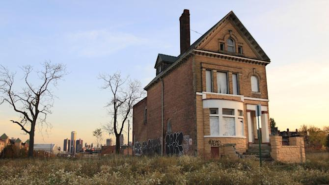 This Oct. 24, 2012, photo shows an abandoned home north of Detroit's downtown. When baseball's World Series returns to Detroit this weekend for Game 3, television viewers will see vibrant crowds and skyline shots of the city. Yet beyond the hot dogs and home runs, Detroit is struggling to cross home plate. (AP Photo/Carlos Osorio)