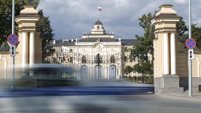 A car drives past the Constantine Palace, which will be the venue for a G20 meeting, in St. Petersburg, Russia on Wednesday, Sept. 4, 2013. U.S. President Barack Obama will seek to bolster international support for a strike against Syria during talks with world leaders this week at the Group of 20 summit. Those efforts will pit him against Russian president and summit host Vladimir Putin, who has perhaps done the most to stymie international efforts to oust Syria's Bashar Assad. The G20 summit will run from Sept. 5-6. (AP Photo/Dmitry Lovetsky)