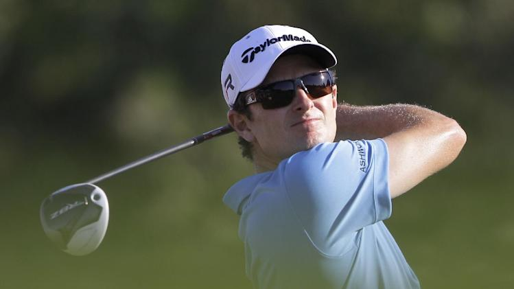 Justin Rose of England follows his ball on the 16th hole during the third round of Abu Dhabi Golf Championship in Abu Dhabi, United Arab Emirates, Saturday, Jan. 19, 2013. (AP Photo/Kamran Jebreili)