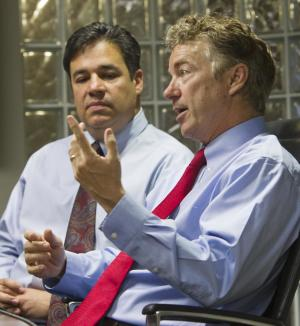 Sen. Rand Paul, right, a potential presidential candidate, makes time for a brief media visit at Jackson's Jet Center in Boise with Rep. Raul Labrador while the two were on their way to the Idaho Republican Convention in Moscow, Idaho, Friday, June 13, 2014. (AP Photo/The Idaho Statesman, Darin Oswald) LOCAL TV OUT (KTVB 7)