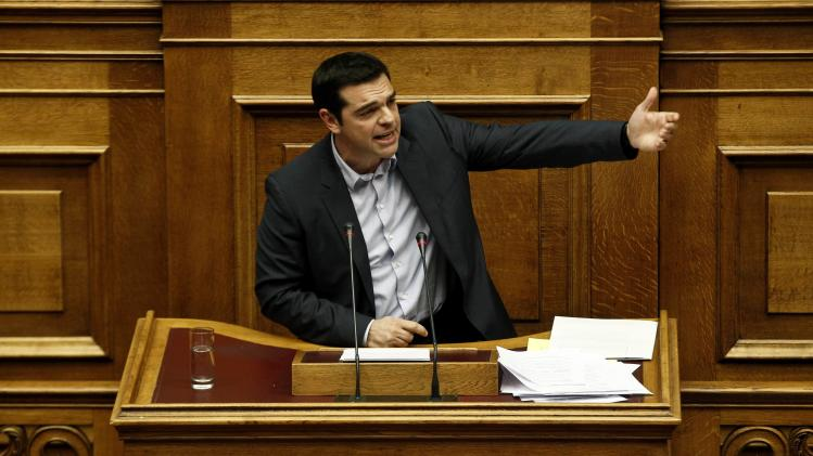 Greek leftist opposition leader Alexis Tsipras delivers a speech during a parliament session where lawmakers vote on the 2014 budget in Athens