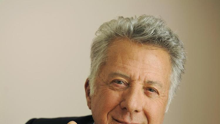 "FILE - In this Sept. 10, 2012 file photo, Dustin Hoffman, director of the film ""Quartet,"" poses for a portrait at the 2012 Toronto Film Festival, in Toronto.  The 75-year-old Hoffman went behind the camera for ""Quartet,"" starring Maggie Smith, Tom Courtenay, Billy Connolly and Pauline Collins as aging British opera divas at a retirement home for musicians who put aside past differences for a reunion concert. (Photo by Chris Pizzello/Invision/AP, File)"