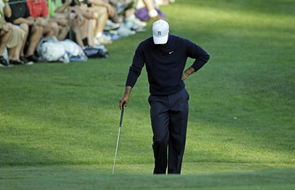 Tiger Woods waits to hits out of a bunker on the 16th hole during the second round of the Masters golf tournament Friday, April 6, 2012, in Augusta, Ga. (AP Photo/Matt Slocum)