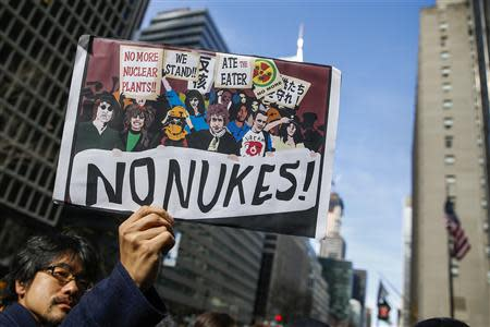 A demonstrator protest against nuclear power on the anniversary of Fukushima earthquake and tsunami in New York