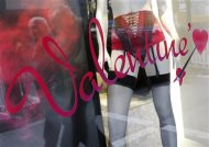 Men are reflected in a shop window of a lingerie store on the eve of St Valentine&#39;s Day in Frankfurt February 13, 2013. REUTERS/Lisi Niesner