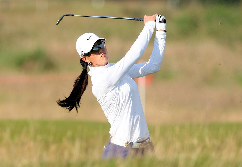 Michelle Wie of the USA, play's her second shot on the third fairway, during the first round of the Women's British Open at Carnoustie Golf Club, Carnoustie, Scotland, Thursday July 28, 2011.(AP Photo/Scott Heppell)