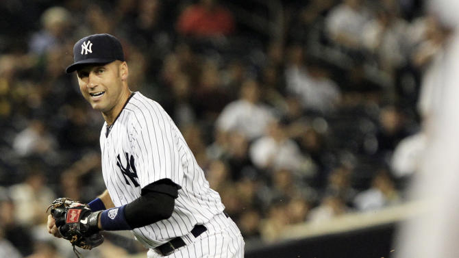 New York Yankees shortstop Derek Jeter drops the ball for an error during the fourth inning of a baseball game against the Tampa Bay Rays Thursday, Sept. 22, 2011, at Yankee Stadium in New York. (AP Photo/Frank Franklin II)