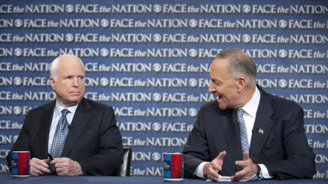"""In this photo provided by CBS News, Sen. John McCain, R-Ariz., and Sen. Chuck Schumer, D-N.Y., appear on Sunday, April 7, 2013, on CBS' """"Face the Nation."""" McCain and Schumer spoke about gun legislation, the latest developments with North Korea and immigration, with Schumer saying he's hoping for a bipartisan deal by the end of this week on a sweeping immigration bill to secure the border and allow eventual citizenship to the estimated 11 million people living here illegally. (AP Photo/CBS News, Chris Usher)"""