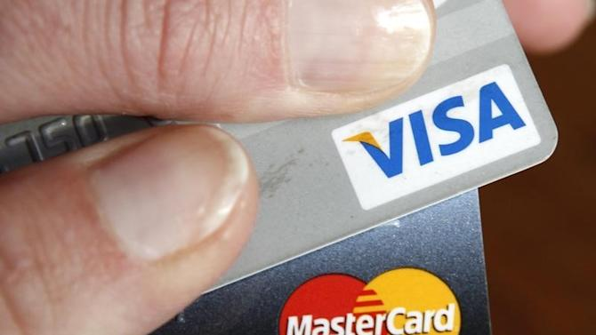 A consumer holds her credit cards in Washington
